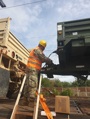 U.S. Army Reserve Sgt. Fabio Gaviria of the 793rd Movement Control Team, 446th Movement Control Battalion, 510th Regional Support Group, 7th Mission Support Command, removes satellite tags from equipment shipped by rail from Bergen-Hohne to Coleman Barracks, Germany, Sept. 13, 2020.  MCT Soldiers under the 446th tracked more than 2,600 pieces of redeployed equipment to close out their support to DEFENDER-Europe 20 Plus. (U.S. Army Reserve photo by Staff Sgt. Christopher Pelican)