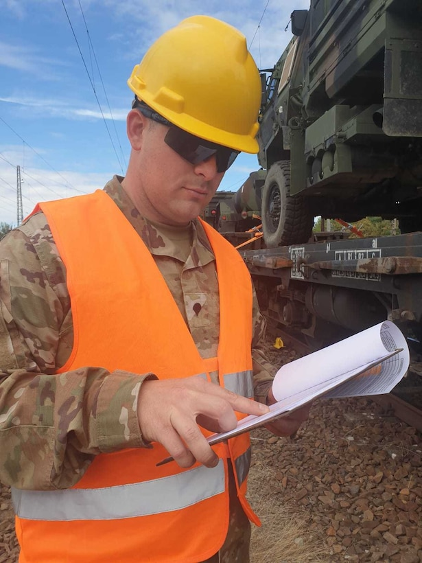 U.S. Army Reserve Spc. Erik Stoops of the 530th Movement Control Team, 446th Movement Control Battalion, 510th Regional Support Group, 7th Mission Support Command, verifies a manifest of equipment shipped by rail from Bergen-Hohne to Coleman Barracks, Germany, Sept. 13, 2020.  MCT Soldiers under the 446th tracked more than 2,600 pieces of redeployed equipment to close out their support to DEFENDER-Europe 20 Plus. (U.S. Army Reserve photo by Staff Sgt. Christopher Pelican)