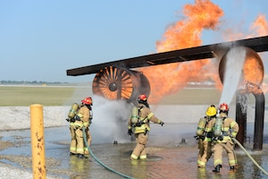 Four new firefighters with the Nebraska Air National Guard Base Fire Department receive training on Aircraft Rescue Firefighter (ARFF) operations, Aug. 26, 2020, at Offutt Air Force Base in Bellevue, Neb.  Since firefighter schools closed for COVID-19 concerns, the Nebraska Air National Guard decided to conduct the required training on its own in Lincoln and at Offutt Air Force Base for the newly-hired firefighters. (Nebraska Air National Guard photo by Tech. Sgt. R. Denise Mommens)