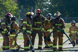 Offutt Air Force Base Fire Department Firefighter, Brent Bergstrom, advises new firefighters with the Nebraska Air National Guard Base Fire Department during training on Aircraft Rescue Firefighter (ARFF) operations, Aug. 26, 2020, at Offutt Air Force Base in Bellevue, Neb.  Since firefighter schools closed for COVID-19 concerns, the Nebraska Air National Guard decided to conduct the required training on its own in Lincoln and at Offutt Air Force Base for the newly-hired firefighters. (Nebraska Air National Guard photo by Tech. Sgt. R. Denise Mommens)