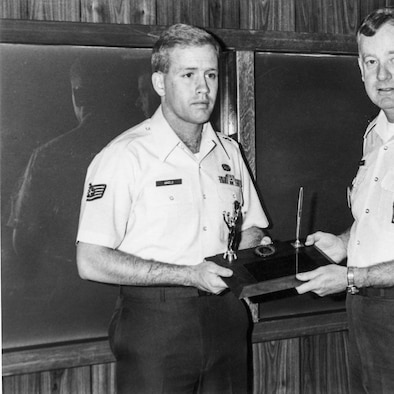 Then Staff Sgt. Jack Angelo, an Agent Trainee at Office of Special Investigations Detachment 2006, Malmstrom Air Force Base, Mont., receives the John Levitow Honor Graduate Award from the Leadership School's 341st Missile Wing commander in July 1986. The event was publicized in the base newspaper. (Courtesy photo)