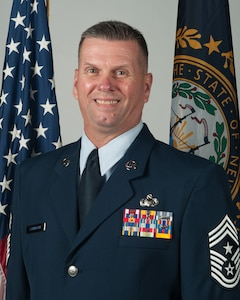Offical Portrait of U.S. Air Force Chief Master Sgt. John Symington, the New Hampshire Air National Guard's 12th state command chief, June 28, 2019, Pease Air National Guard Base, N.H. (U.S. Air National Guard photo by Tech. Sgt. Aaron P. Vezeau)