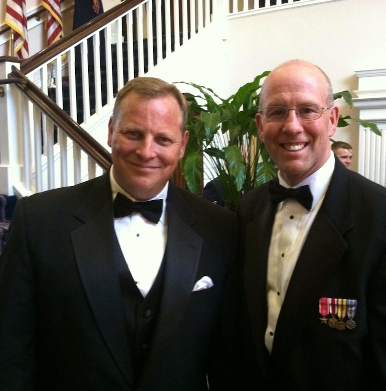 Special Agent Jack Angelo poses with former Office of Special Investigations crime fighting partner, now OSI Headquarters Organizational Development Director, Mr. Ken Sallinger, at an Order of the Sword ceremony in 2013. (Courtesy photo)