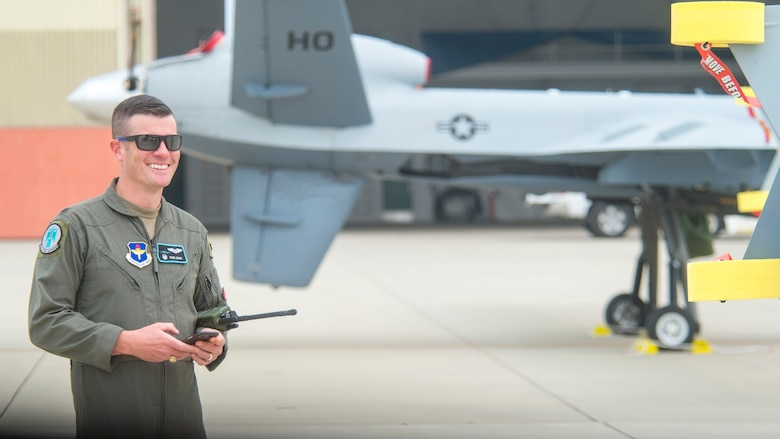 Col. Brian Davis, 29th Attack Squadron commander, smiles prior to a MQ-9 Reaper launch during Exercise Agile Reaper, Sept. 15, 2020, at Naval Air Station Point Mugu, California. This training exercise focuses on the improvement of total force relationships, training the next generation of combat airpower, building operational capabilities and demonstrating the agile, penetrating and persistent multi-role maritime combat capabilities of the MQ-9 Reaper. (U.S. Air Force photo by Senior Airman Collette Brooks)