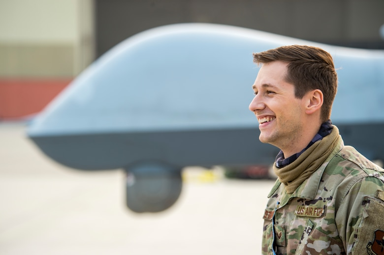 Senior Airman Zachary Stricklett, 9th Aircraft Maintenance Unit avionics expeditor, smiles during Exercise Agile Reaper, Sept. 15, 2020, at Naval Air Station Point Mugu, California. This routine training exercise focuses on the rapid deployment of MQ-9 Reapers to a maritime location using minimal personnel, fuel and equipment and reducing deployment timelines from weeks to a few hours.  (U.S. Air Force photo by Senior Airman Collette Brooks)
