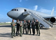 From left, Capt. Erik Earle, Capt. Chris Schimmel, Maj. Matt Valentino, Master Sgt. Brett Peterson, Capt. Jordan Gauvin, Chief Master Sgt. Michael George and Maj. Leon Rice stand with a KC-46A Pegasus on Sept. 8, 2020, at Kadena Air Base, Japan.