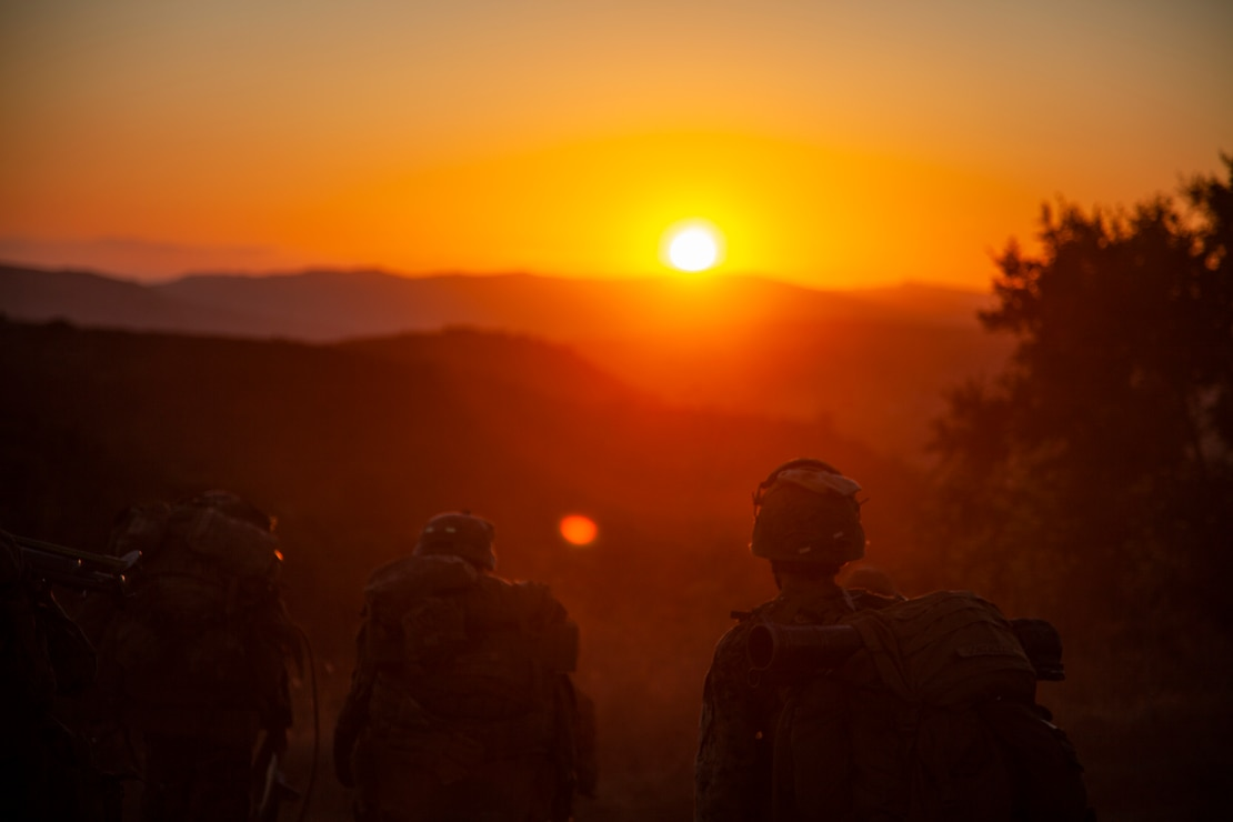 U.S. Marines hike after conducting an aerial assault at Marine Corps Base Camp Pendleton, Calif., Aug. 7.