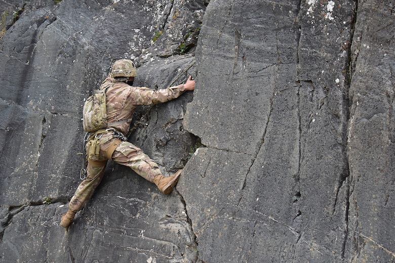 An Advanced Military Mountaineering Course student searches for a route up a rock face at the Northern Warfare Training Center's Black Rapids Site during training. NWTC cadre followed Coronavirus restrictions while guiding students through both the basic and advanced mountaineering courses in August. With the advent of Alaska's long, cold winter, NWTC's focus is now shifting to cold weather training for the 2020-21 season.