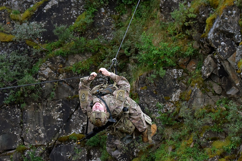 Basic Military Mountaineering Course student 1st Lt. Christopher Peer crosses a one-rope bridge over a mountain gorge at the Northern Warfare Training Center's Black Rapids Site during training. NWTC cadre followed Coronavirus restrictions while guiding students through both the basic and advanced mountaineering courses in August. With the advent of Alaska's long, cold winter, NWTC's focus is now shifting to cold weather training for the 2020-21 season.