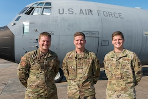 """Tech Sgt. Seth, Staff Sgt. Paul, and Senior Airman Mark Johnson, all crew chiefs in the 403rd Wing at Keesler Air Force Base, Miss., pause from their workday for a photo in front of Seth's C-130J Super Hercules Sept. 9, 2020. The three Air Reserve Technicians are brothers from Bay St. Louis who serve in the three different maintenance squadrons servicing the 815th Airlift Squadron's C-130J """"Flying Jennies"""" and the 53rd Weather Reconnaissance Squadron's """"Hurricane Hunters."""" (U.S. Air Force photo by Senior Airman Kristen Pittman)"""