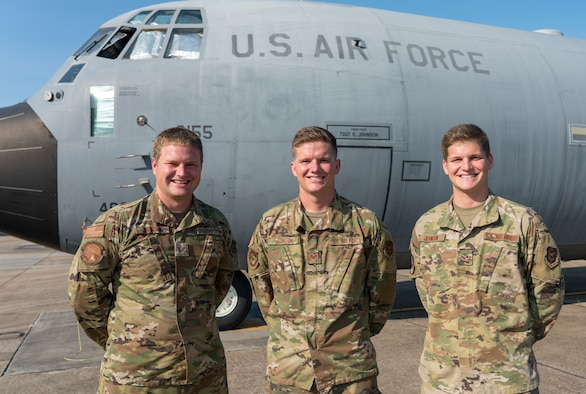 "Tech Sgt. Seth, Staff Sgt. Paul, and Senior Airman Mark Johnson, all crew chiefs in the 403rd Wing at Keesler Air Force Base, Miss., pause from their workday for a photo in front of Seth's C-130J Super Hercules Sept. 9, 2020. The three Air Reserve Technicians are brothers from Bay St. Louis who serve in the three different maintenance squadrons servicing the 815th Airlift Squadron's C-130J ""Flying Jennies"" and the 53rd Weather Reconnaissance Squadron's ""Hurricane Hunters."" (U.S. Air Force photo by Senior Airman Kristen Pittman)"