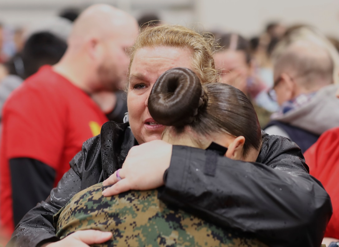 Marines embrace their loved ones during Family Day at Marine Corps Recruit Depot Parris Island, S.C., March 5.