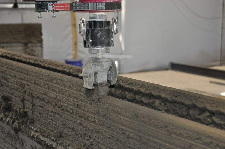 The U.S. Army Engineer Research and Development Center, Construction Engineer Research Laboratory's concrete 3D printing apparatus precisely lines up individual concrete layers during the printing process.