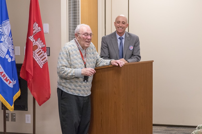 Bud Ossey talks to current engineers and fellow retirees of Portland District, U.S. Army Corps of Engineers during a historical celebration at the district's headquarters in downtown Portland in November 2019. Ossey attended as a guest of honor.