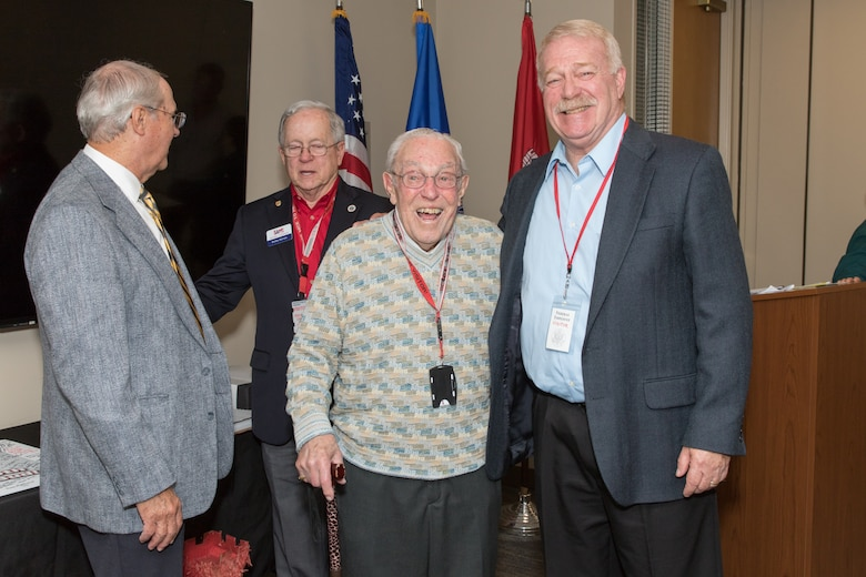 Bud Ossey (center) reconnects with fellow retirees of Portland District, U.S. Army Corps of Engineers during a historical celebration at the district's headquarters in downtown Portland in November 2019. Ossey attended as a guest of honor.