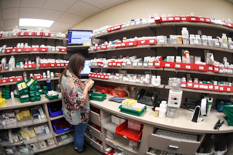 Pharmacy technician Shelby Moss prepares prescriptions at the  Satellite Pharmacy located inside the AAFES Base Exchange at Hill Air Force Base. Beginning Nov. 2, the Satellite Pharmacy windows will reopen.