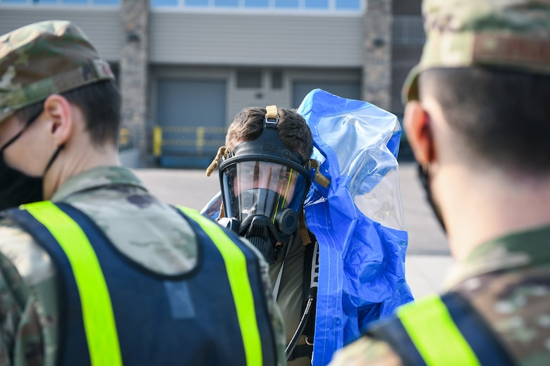 Senior Airman Justin Kunkler, a 460th Operational Medical Readiness Squadron journeyman, dons his full hazardous materials (hazmat) suit during the Ready Eagle exercise where a simulated explosion occurred Sept. 18, 2020, at the Air Reserve Personnel Center on Buckley Air Force Base, Colo.