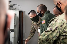 Adm. Charles A. Richard, U.S. Strategic Command commander, looks at a Global Aircrew Strategic Network Terminal (Global ASNT) during his tour of Barksdale Air Force, La., Sept. 21, 2020. Richard visited various units around Barksdale to see how the 2nd Bomb Wing, Air Force Global Strike Command and 8th Air Force fit into the USSTRATCOM mission of deterring strategic attack and employing forces, as directed, to guarantee the security of the nation and its allies. (U.S. Air Force photo by Airman 1st Class Jacob B. Wrightsman)