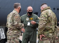 Adm. Charles A. Richard, center, U.S. Strategic Command commander, talks with Gen. Timothy M. Ray, left, Air Force Global Strike Command commander, and Col. Mark C. Dmytryszyn, right, 2nd Bomb Wing commander, during Richard's visit to Barksdale Air Force Base, La., Sept. 21, 2020. Richard visited various units around Barksdale to see how the 2nd Bomb Wing, Air Force Global Strike Command and 8th Air Force fit into the USSTRATCOM mission of deterring strategic attack and employing forces, as directed, to guarantee the security of the nation and its allies. (U.S. Air Force photo by Airman 1st Class Jacob B. Wrightsman)