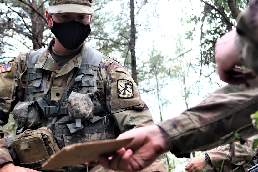 An ROTC cadet wearing a face mask training.