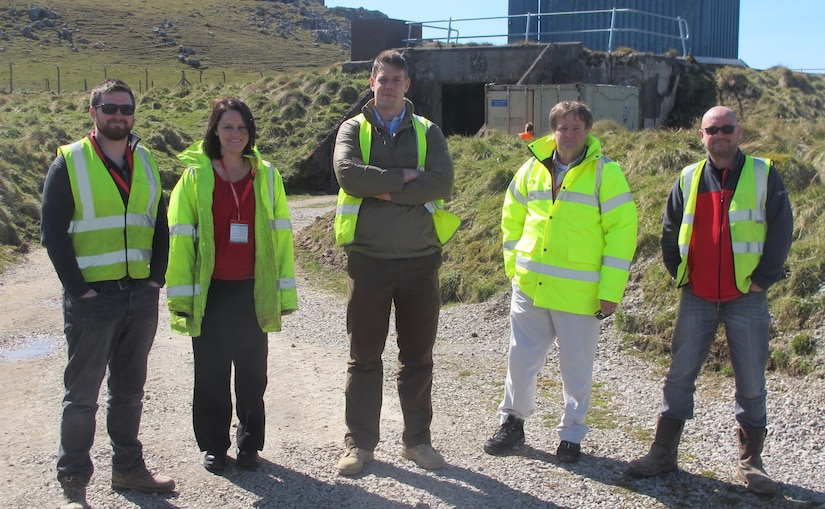 University of Sheffield's Dr. Sam Rigby; U.S. Army Engineer Research and Development Center's (ERDC) Dr. Catie Stephens; Maj. Andy Wilson, U.K. liaison officer to ERDC; ERDC's James Davis; and University of Sheffield's Andy Tyas pictured at the University of Sheffield's blast testing facility in Buxton, U.K., where the Characterisation of Blast Loading testing equipment is located.
