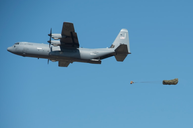 A C-130J performs a low cost low altitude airdrop.
