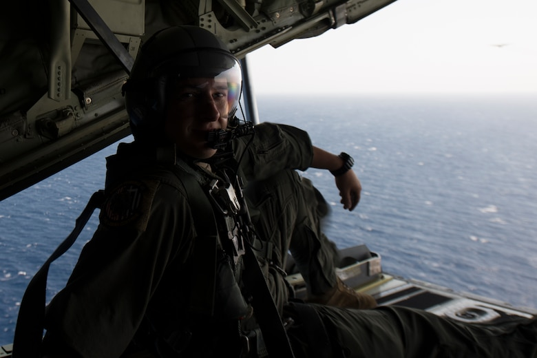 A loadmaster poses for a photo.