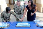 From left to right, Airman Darcy Nguyen, 86th Logistics Readiness Squadron; Lt. Col. Matthew Berridge, DLA Europe & Africa military deputy commander; and Melissa Johnson, DLA Europe & Africa operations officer, cut a cake in honor of the Air Force's 73rd birthday Sept. 18 at Kleber Kaserne in Kaiserslautern, Germany.