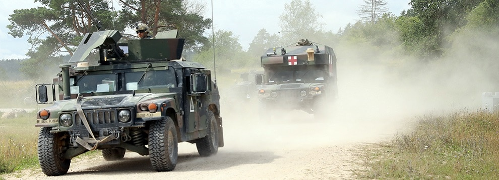 Military Police assigned to the 12th Combat Aviation Brigade escort an Army Ambulance during Exercise Saber Junction 20 at the Hohenfels Training Area, Aug. 17, 2020. (U.S. Army photo by Sgt. Thomas Stubblefield)