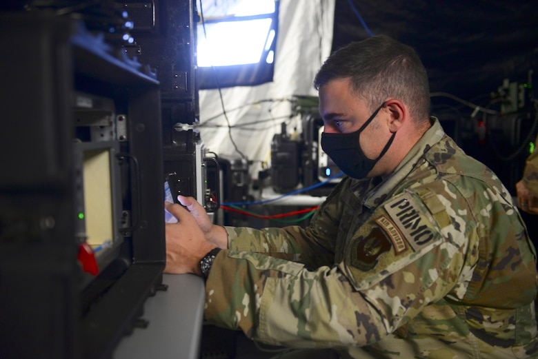 U.S. Air Force Master Sgt. Charles Wilder, 606th Air Control Squadron assistant operations superintendent, manipulates an Ultra High Frequency radio during exercise Astral Knight 20 at Malbork Air Base, Poland, Sept. 22, 2020. Astral Knight 20 is an integrated air and missile defense exercise featuring a combination of flight operations and computer-assisted scenarios. (U.S. Air Force photo by Tech. Sgt. Tory Cusimano)