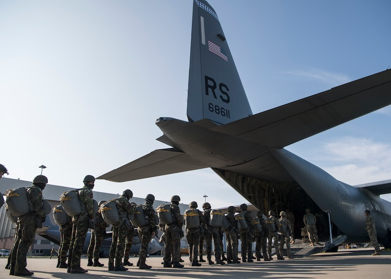 Belgian, Dutch and German airborne military members board a C-130J Super Hercules aircraft, assigned to the 37th Airlift Squadron, at Eindhoven Air Base, Netherlands, Sept. 18, 2020.