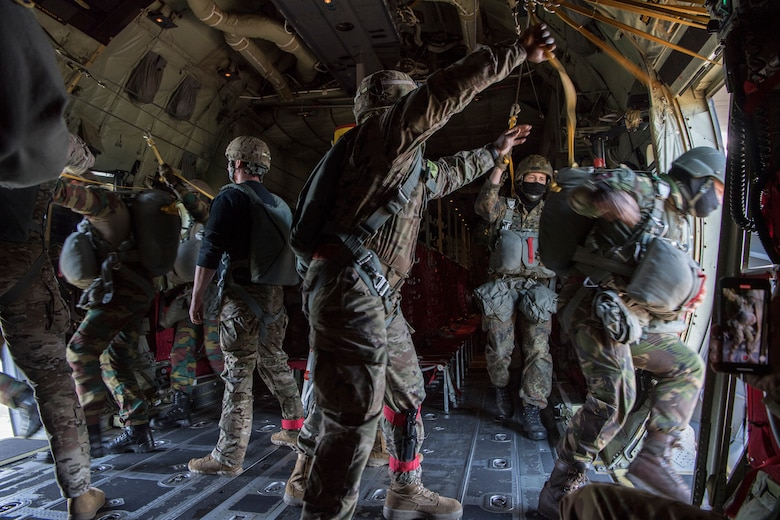 U.S. Army jumpmasters support Belgian, Dutch and German airborne military members while they perform a static line airdrop over the Netherlands, Sept. 18, 2020.