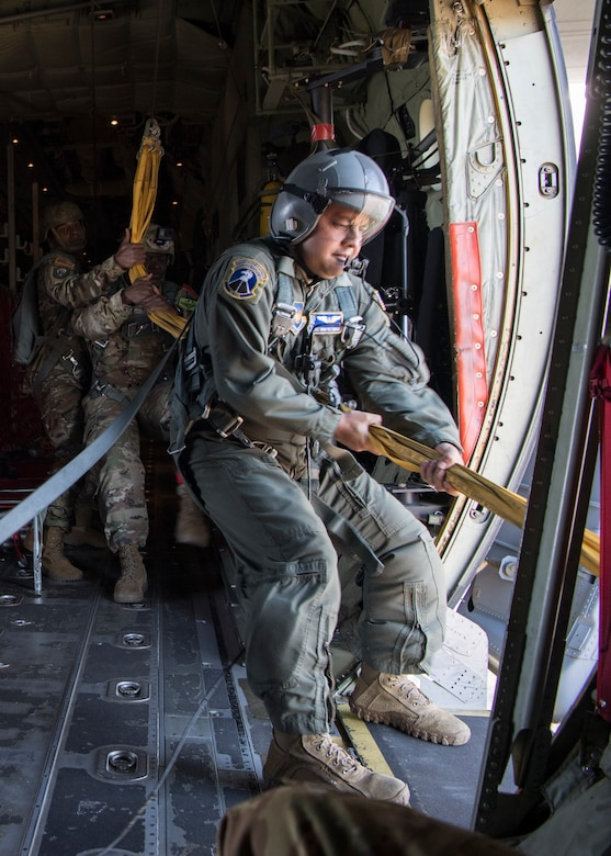 U.S. Air Force Staff Sgt. Bruno Ruiz Camacho, 37th Airlift Squadron loadmaster, pulls static lines after a personnel drop over the Netherlands, Sept. 18, 2020.