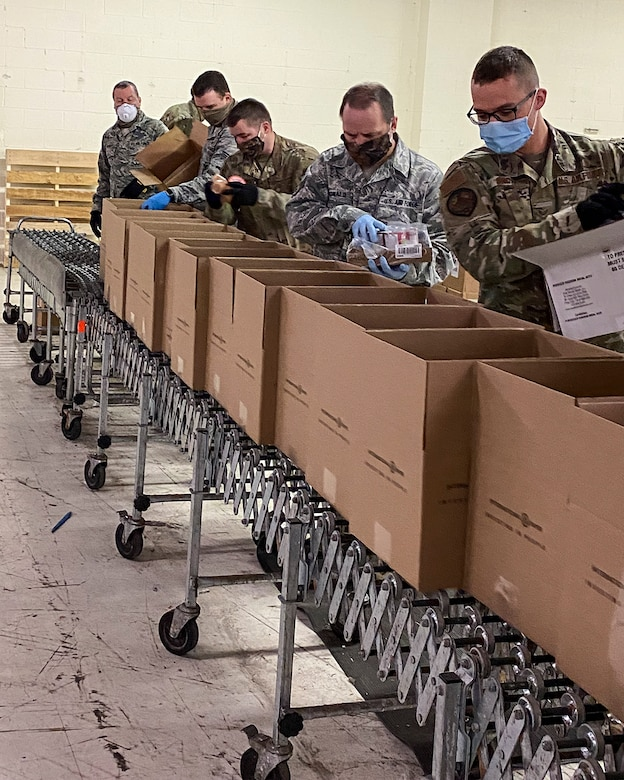 Airmen from the 127th Wing at Selfridge Air National Guard Base, Mich., pack food boxes at Forgotten Harvest Food Pantry in Royal Oak, Michigan on April 22, 2020.  On an average day the Airmen are able to prepare and pack more than 3,500 boxes of food.  The food pantry delivers more than 138,000 pounds of food per day to Michiganders throughout the Metro Detroit area.  Since March 30, Michigan National Guard members have also been supporting local communities at food banks in Comstock Park, Ann Arbor, Pontiac, and Flint. (U.S. Air National Guard photo by Phillip Ulmer)