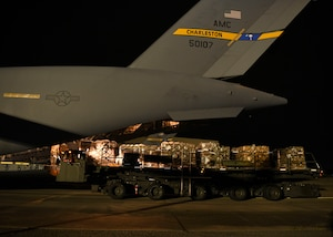 Military personnel onload a mobile field hospital onto a C-17 Globemaster III at Joint Base Charleston, S.C., Sept. 19, 2020.
