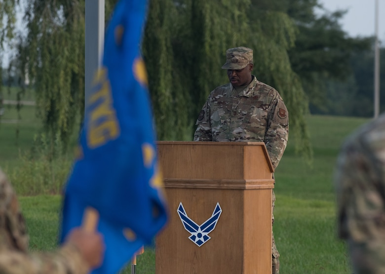 Chief Master Sgt. Nicholas Conner, 509th Logistics Readiness Squadron superintendent, reads the names of American service members who are still missing in action during a 24-hour POW/MIA Remembrance event.
