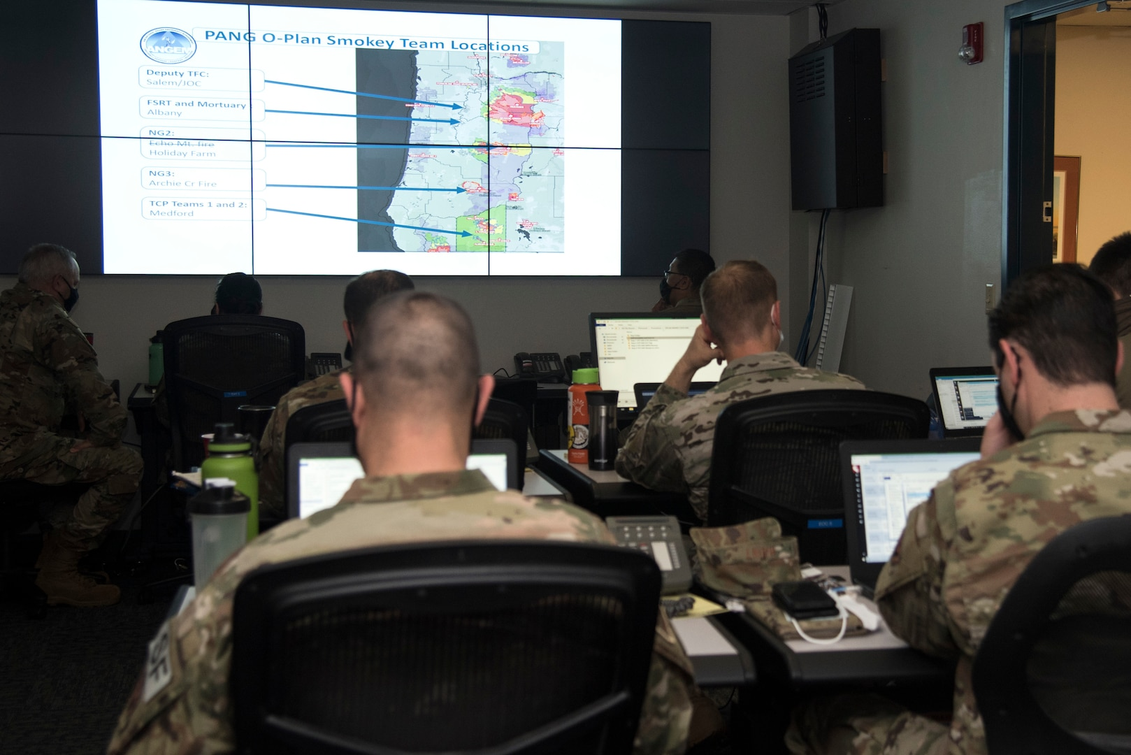 Guardsmen from the 142nd Wing work in the Emergency Operation Center in support of Operation Plan Smokey at the Portland Air National Guard Base, Ore., Sept. 18, 2020. The EOC team communicates with the Oregon Joint Operation Center to provide emergency management for scenarios such as wildfires.