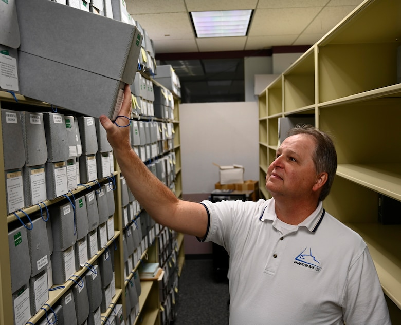 Tony Landis, Air Force Materiel Command Historian, checks for an archive within the History and Heritage Program office at the AFMC Headquarters, Wright-Patterson Air Force Base, Ohio. (Air Force photo by Darrius Parker)