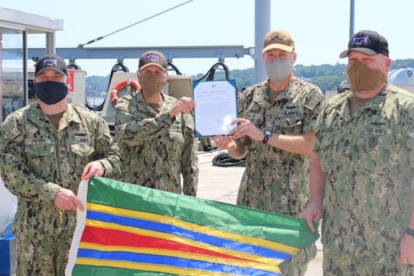 Capt. Andrew Miller, Submarine Squadron 4 commodore, second from right, presents the Meritorious Unit Commendation (MUC) to the crew of the Virginia-class fast-attack submarine USS Minnesota (SSN 783), July 9, 2020.