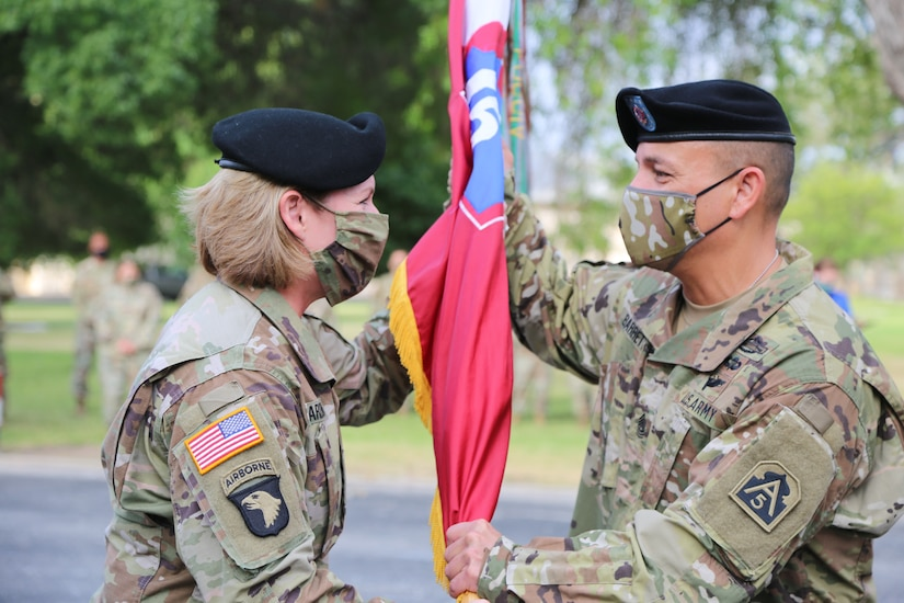 Army Lt. Gen Laura J. Richardson gives Army Command Sgt. Maj. Phil K. Barretto a command flag.