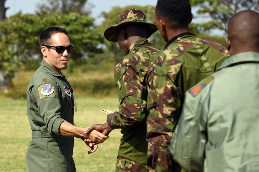 Air Force officer shakes hands with local soldier.