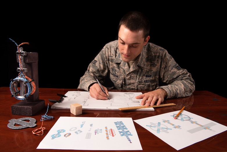 Senior Airman Hartman, 726th Air Command Squadron cyber transport technician, sketches an idea for his invention of a cable management system, Sept. 16, 2020, at Mountain Home Air Force Base, Idaho. Hartman was selected to compete at the Air Combat Command level through the Spark Tank Challenge, which creates an avenue for Airmen to present their ideas to senior leadership. (U.S. Air Force photo by Senior Airman Andrew Kobialka)