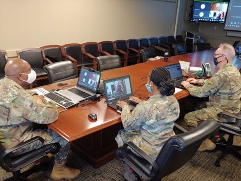 U.S. Army Reserve Lt. Col. Richard James, Sr., command chaplain, Staff Sgt. Monika L. Patterson (center), and Sgt. 1st Class Shawn T. Kilgore (right), religious affairs specialists with the U.S. Army Civil Affairs & Psychological Operations Command, provide network support, coordination, and leadership during mandatory annual Unit Ministry Team (UMT) training for chaplains and religious affairs Soldiers for USACAPOC(A) and its subordinate commands during virtual annual training, Aug. 4 – 7, 2020. USACAPOC(A) ministry teams across the U.S. took part in the advanced UMT training, designed to prepare unit team members with the tools necessary to meet the challenges of working in today's diffused ministry environment, and enable USACAPOC(A) UMT's to meet new USARC ministry standards ahead of schedule. (U.S. Army Photo by Maj. Sean D. Delpech)