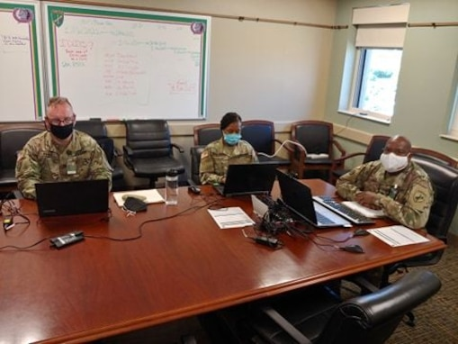 U.S. Army Reserve Sgt. 1st Class Shawn T. Kilgore (left), Staff Sgt. Monika L. Patterson (center), religious affairs specialists, and Lt. Col. Richard James, Sr., (right) command chaplain for the U.S. Army Civil Affairs & Psychological Operations Command, provide network support, coordination, and leadership during mandatory annual Unit Ministry Team (UMT) training for chaplains and religious affairs Soldiers for USACAPOC(A) and its subordinate commands during virtual annual training, Aug. 4 – 7, 2020. USACAPOC(A) ministry teams across the U.S. took part in the advanced UMT training, designed to prepare unit team members with the tools necessary to meet the challenges of working in today's diffused ministry environment, and enable USACAPOC(A) UMT's to meet new USARC ministry standards ahead of schedule. (U.S. Army Photo by Maj. Sean D. Delpech)