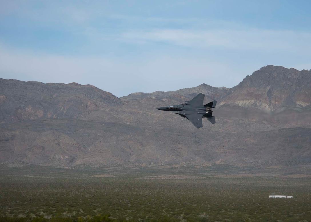 Aircraft flies over range.