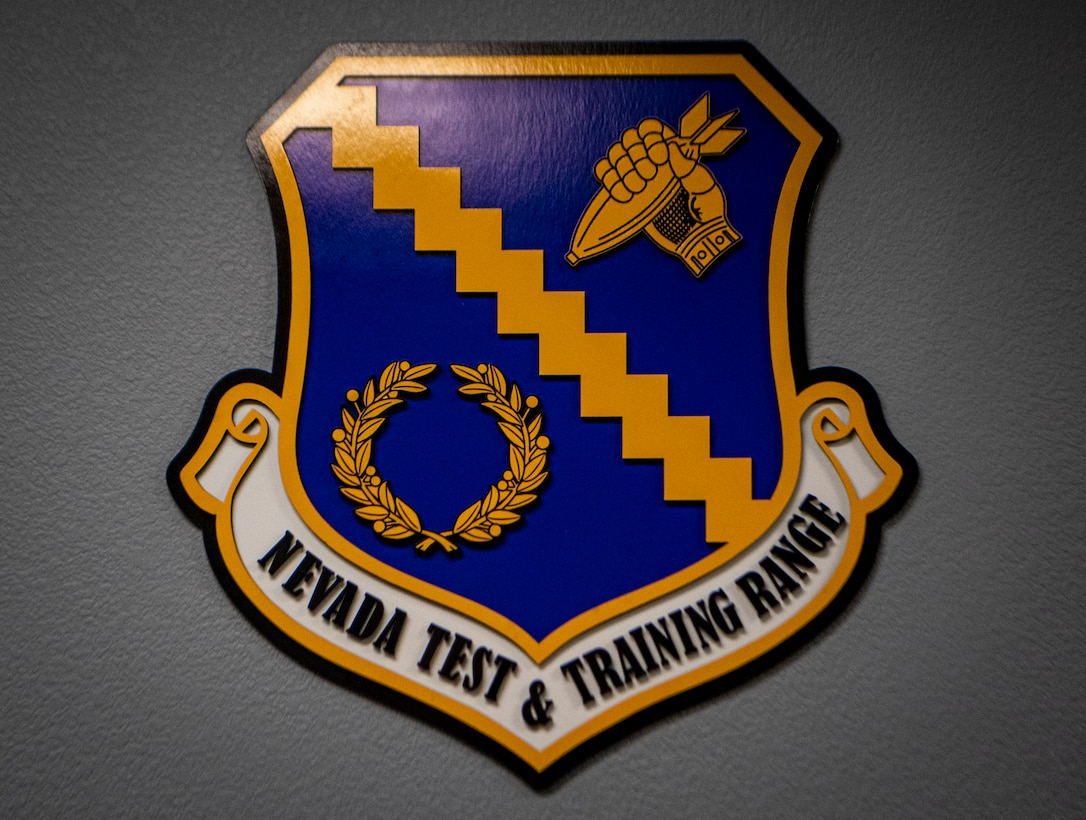 Nevada Test and Training Range crest on a wall.