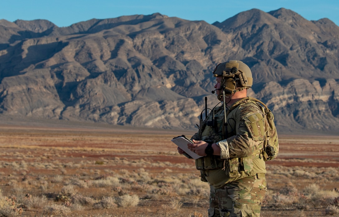 Airman stands in the middle of a range.