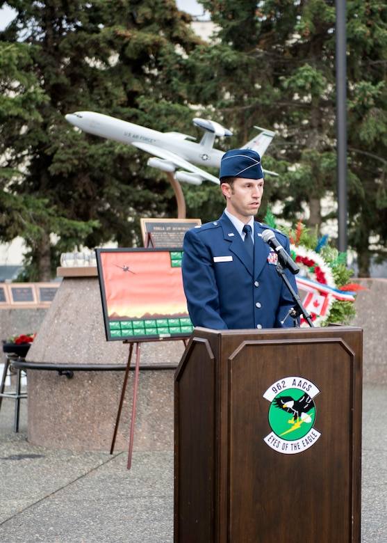 U.S. Air Force Lt. Col. Clint Hammer, 962nd Airborne Air Control Squadron director of operations, speaks at the Yukla 27 25th anniversary memorial ceremony at Joint Base Elmendorf-Richardson, Alaska, Sept. 22, 2020. Yukla 27, a U.S. Air Force E-3 Sentry airborne warning and control system aircraft assigned to the 962nd AACS, encountered a flock of geese Sept. 22, 1995, and crashed shortly after takeoff on a routine surveillance training sortie, killing all 24 Canadian and U.S. Airmen aboard.