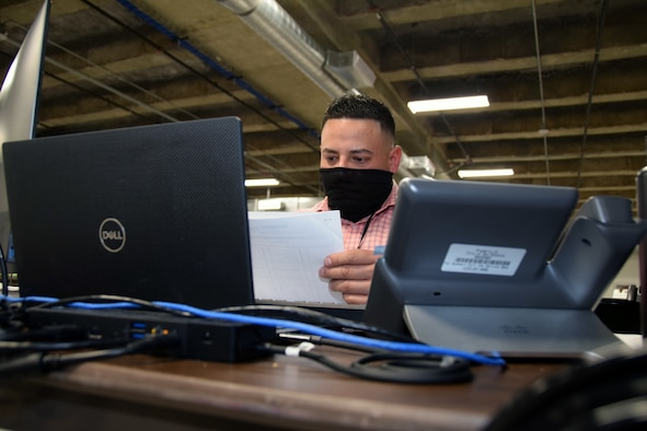Tech. Sgt. Juan Vazquez Garcia, 433rd Medical Group, processes a COVID-19 positive case report as a case investigator at the Bexar County COVID-19 Operations center in San Antonio, Texas Sept. 17, 2020.