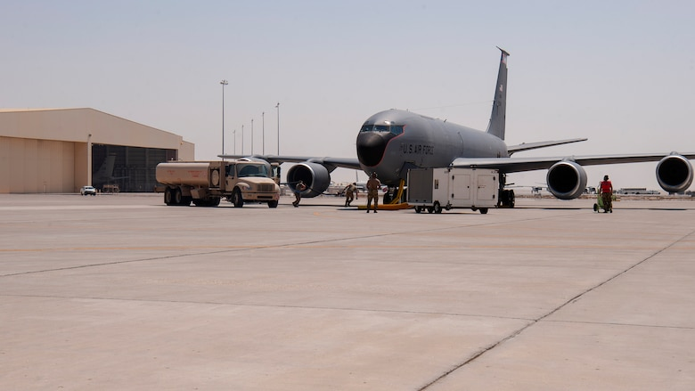 U.S. Air Force mobile distribution operators from the 379th Air Expeditionary Logistics Readiness Squadron participate in a KC-135 Stratotanker aircraft hot refueling training scenario at Al Udeid Air Base, Qatar, Sept. 21, 2020. This scenario exercises the ability to refuel a KC-135 with one or more engines running and directly advances mission agility in the U.S. Central Command's area of responsibility.
